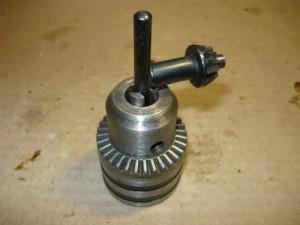 Вид на отремонтированный патрон с зажатым ключом