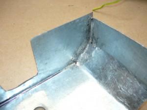 Вид на запаянный шов заготовки крышки на кронштейн