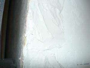Намазанная шпаклевка на косяк оконного проема