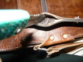 Вспарывание боковины портфеля