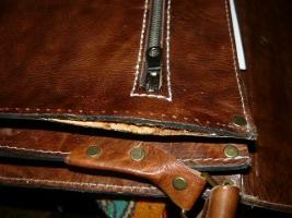 Проклейка замка в боковинах портфеля