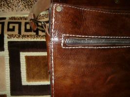 Окончание прошивки боковины портфеля
