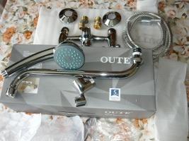 Купленный комплект крана с душем марки QUTE