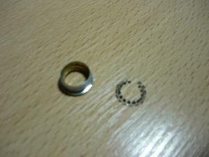 топорное кольцо, вынутое из обоймы штуцера